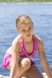 Muchacha linda enojada en traje de baño rosado Fotografía de archivo libre de regalías