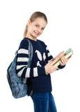 Muchacha linda feliz que sostiene un libro en sus manos Foto de archivo libre de regalías