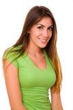 Muchacha linda que desgasta la camiseta verde Imagenes de archivo