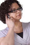 Muchacha linda que habla en el teléfono Foto de archivo libre de regalías