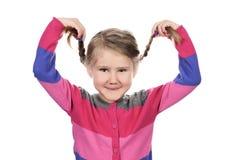 Muchacha linda que hace la cara divertida Foto de archivo libre de regalías