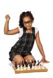 Muchacha linda que juega a ajedrez en blanco Imágenes de archivo libres de regalías