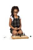 Muchacha linda que juega a ajedrez en blanco Imagen de archivo libre de regalías