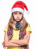 Muchacha linda que lleva el sombrero de Santa Claus Foto de archivo libre de regalías