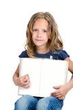 Muchacha linda que señala con el dedo en el libro en blanco. Imagen de archivo libre de regalías