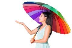 Muchacha linda que sostiene el paraguas Imagenes de archivo