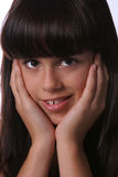 Muchacha linda smirking en un headshot Fotografía de archivo libre de regalías