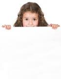 Muchacha linda sobre tarjeta en blanco Fotos de archivo