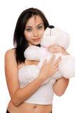 Muchacha linda sonriente con un teddybear Imagenes de archivo