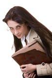 Muchacha lista con el libro viejo. Imagen de archivo