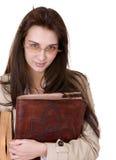 Muchacha lista con el libro viejo. Foto de archivo