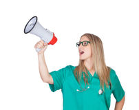 Muchacha médica atractiva con un megáfono Imágenes de archivo libres de regalías