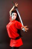 Muchacha mística con la espada. Fotos de archivo libres de regalías