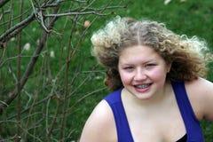 Muchacha media con el pelo que sopla Foto de archivo