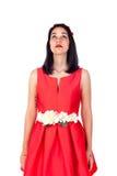 Muchacha morena adorable en rojo aislada en un fondo blanco Fotografía de archivo