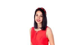 Muchacha morena adorable en rojo aislada en un fondo blanco Imágenes de archivo libres de regalías