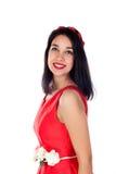 Muchacha morena adorable en rojo aislada en un fondo blanco Fotografía de archivo libre de regalías