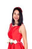 Muchacha morena adorable en rojo aislada en un fondo blanco Imagen de archivo