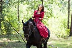 Muchacha morena en caballo Foto de archivo