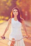 Muchacha morena en la bicicleta Imagenes de archivo