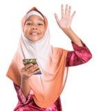 Muchacha musulmán joven con el lápiz y la libreta VIII Fotografía de archivo