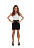 Muchacha natural con la mini-falda y el pelo rizado Imágenes de archivo libres de regalías