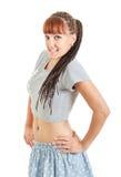 Muchacha o mujer bonita de Miling en mini falda y camiseta del cortocircuito Foto de archivo libre de regalías