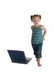 Muchacha ocasional con la computadora portátil Imagen de archivo