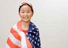 Muchacha patriótica con el indicador americano Fotos de archivo