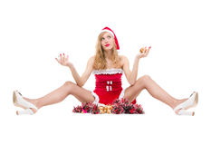 Muchacha pensativa de la Navidad en el sombrero rojo de santa Fotografía de archivo libre de regalías