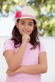 Muchacha pensativa del niño de diez años con un sombrero Imágenes de archivo libres de regalías