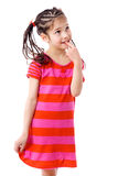 Muchacha pensativa en alineada rosada Foto de archivo libre de regalías