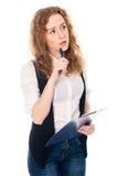 Muchacha pensativa joven con el cuaderno Fotos de archivo libres de regalías