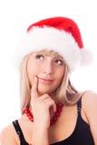 Muchacha pensativa que desgasta el sombrero de Santa fotos de archivo