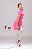 Muchacha Pin-para arriba en alineada rosada Fotografía de archivo libre de regalías