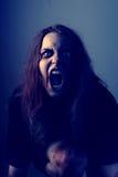 Muchacha poseída enojada Fotografía de archivo