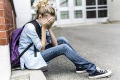 Muchacha pre adolescente infeliz en la escuela Imagen de archivo libre de regalías