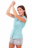 Muchacha preciosa en camisa azul con los brazos para arriba Fotos de archivo