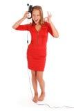 Muchacha preciosa que escucha una música con los auriculares Imagen de archivo libre de regalías
