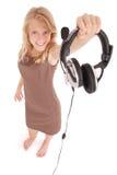 Muchacha preciosa que escucha una música con los auriculares Fotos de archivo libres de regalías