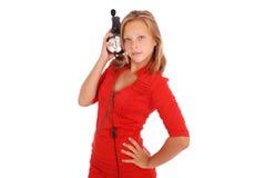 Muchacha preciosa que escucha una música con los auriculares Fotografía de archivo libre de regalías