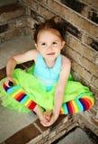 Muchacha preescolar con el lechón del tutú y del caramelo Foto de archivo libre de regalías