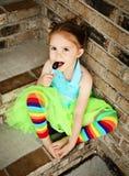 Muchacha preescolar con el lechón del tutú y del caramelo Fotos de archivo libres de regalías
