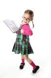 Muchacha preescolar con el libro Imagen de archivo libre de regalías