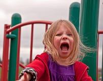 Muchacha preescolar enojada en patio Foto de archivo libre de regalías