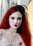 Muchacha principal roja con maquillaje Fotos de archivo