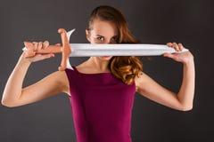 Muchacha pura joven hermosa de la princesa con una espada Imagen de archivo libre de regalías