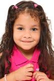 Muchacha que abotona la camisa Imagen de archivo libre de regalías