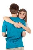 Muchacha que abraza al individuo Imagen de archivo libre de regalías