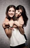 Muchacha que abraza a su hermana Fotografía de archivo libre de regalías